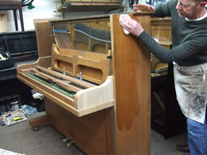 Piano Polishing in our workshop near London